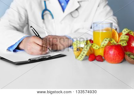 Doctor counting calories in hospital