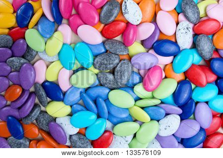 Vibrantly Colorful Candy Pebbles Spread Evenly. Colorful Background.