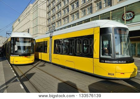 BERLIN OCTOBER 27: Yellow tram in city street on October 27 2014 in Berlin Germany. The tram in Berlin is one of the oldest tram systems in the world.