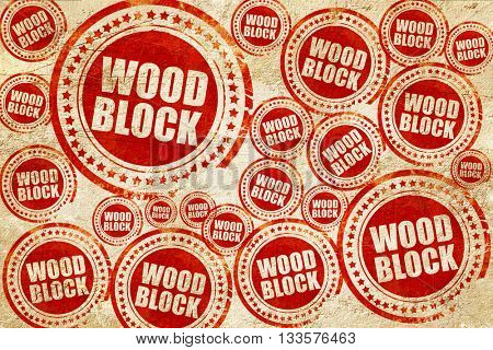 wood block, red stamp on a grunge paper texture