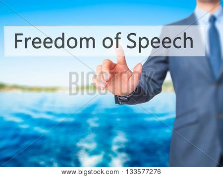 Freedom Of Speech - Businessman Hand Pressing Button On Touch Screen Interface.