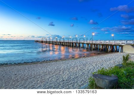 Baltic sea with pier in Gdynia Orlowo at sunrise, Poland