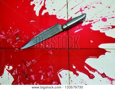 knife and lot of blood on tile floor