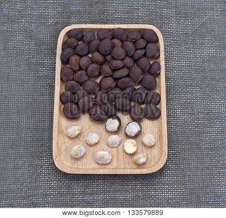 Plukenetia volubilis sacha inchi sacha peanut mountain peanut Inca-peanut on wooden plate