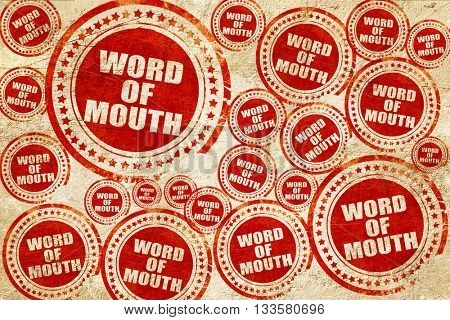 word of mouth, red stamp on a grunge paper texture