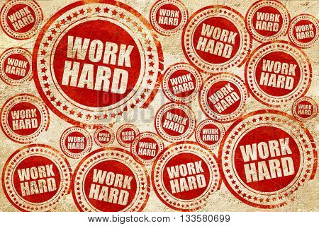 work hard, red stamp on a grunge paper texture