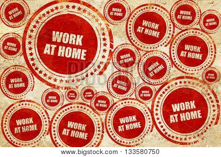 work at home, red stamp on a grunge paper texture