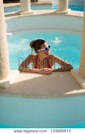 Woman Relaxing On Summer Vacation At Pool Jacuzzi