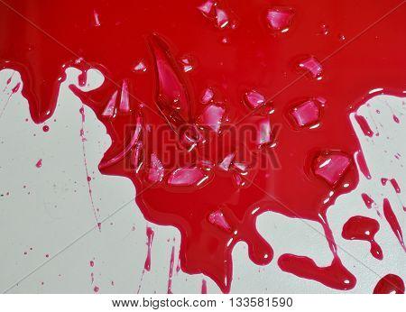 red liquid splash on home tile floor