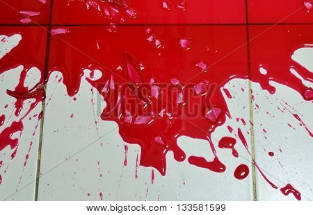 red blood splash on house tile floor