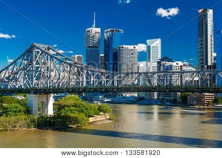 BRISBANE, AUS - JUN 7 2016: Panoramic view of Brisbane Skyline with Story Bridge and the river. It is Australias third largest city, capital of Queensland.
