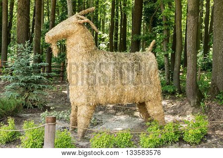 Big straw effigy goat in the woods
