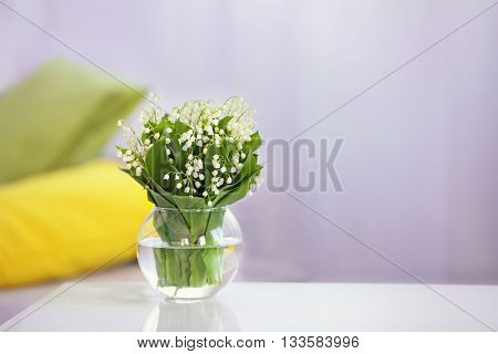 Bouquet of fresh spring flowers on the table indoors