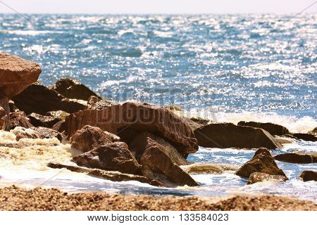 Rock seacoast with sea on background