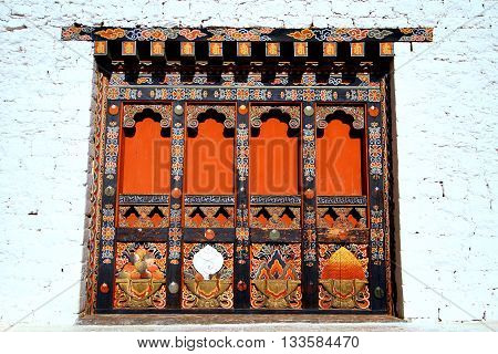 Bhutanese unique and local art painted on wooden doors