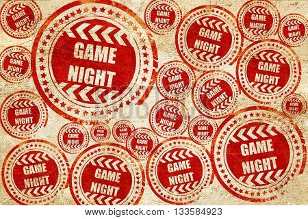 Game night sign, red stamp on a grunge paper texture