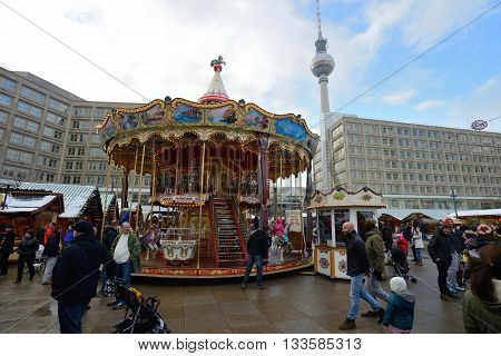 BERLIN - DECEMBER 26: Unidentified people in traditional Christmas fair in Alexanderplatz on 26 December 2014 in Berlin, Germany. Berlin is the capital city of the German Christmas Markets.