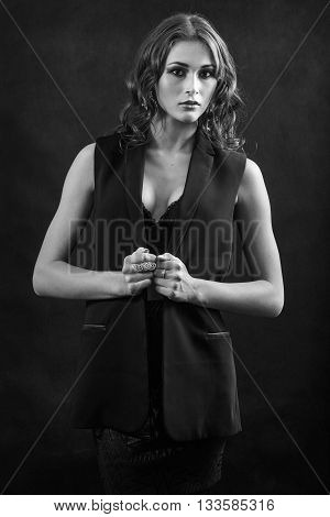 sensual woman with big breast on black background monochrome image