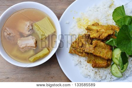 curry pork bone on rice eat with bitter cucumber boiled soup