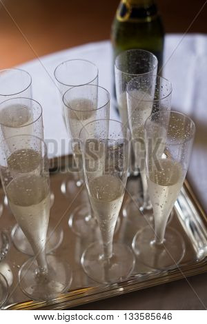 crystal champagne glasses flutes on silver tray