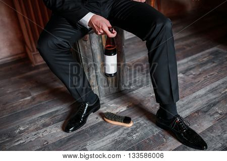 Cleaning shoes on wooden background. black shoe with a brush. Black cream