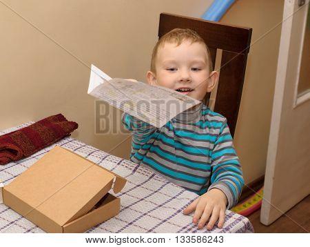 Boy With A Cardboard Box