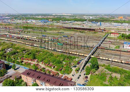 Tyumen, Russia - May 25, 2015: Aerial view on Voynovka railway node. Pedestrian bridge