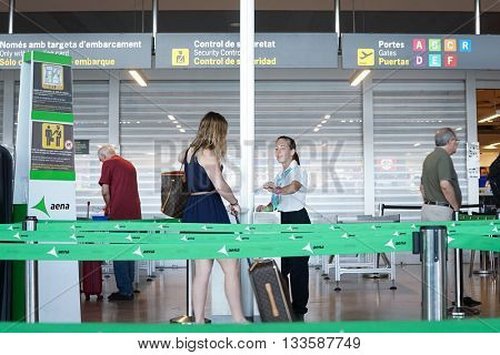 VALENCIA, SPAIN - JUNE 9, 2016: Airline passengers checking in at the security line at the Valencia Airport. About 4.98 million passengers passed through the airport in 2015.