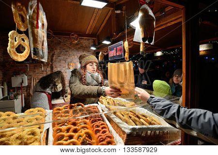 BERLIN - DECEMBER 26: Unidentified people trades food in annual traditional Christmas fair in Alexanderplatz on 26 December 2014 in Berlin Germany.