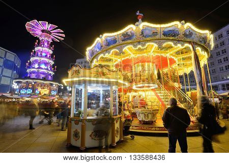 BERLIN - DECEMBER 26: Unidentified people in traditional Christmas fair in Alexanderplatz on 26 December 2014 in Berlin Germany. Berlin is the capital city of the German Christmas Markets.