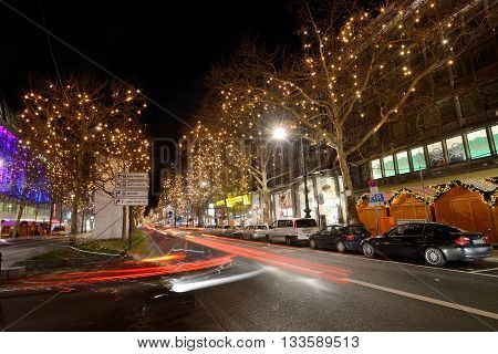 BERLIN - DECEMBER 26: Night traffic and Christmas illuminations on 26 December 2014 in Berlin Germany. With a population of 3.5 million people Berlin is Germany's largest city.