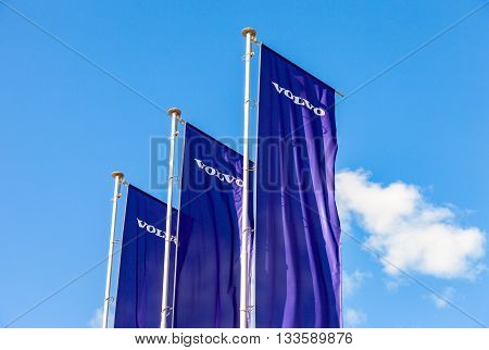 ST.PETERSBURG RUSSIA - AUGUST 5 2015: Volvo dealership flags over blue sky. Volvo is a Swedish multinational automaker company