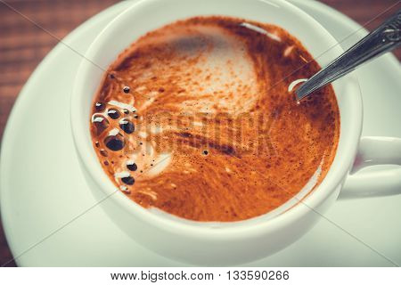 Beautiful Background With A Hot Cup Of Coffee With Crema On Wooden Background