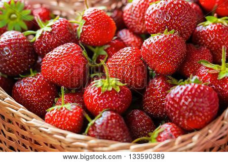 Very Beautiful Background With Fresh Strawberries In A Wicker Heart Shaped Wickerwork Basket