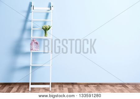 Empty room with white ladder  on blue wall background