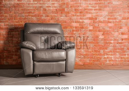 Arm chair on brick wall background