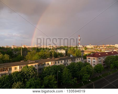 The city outdoor Factory chimneys and rainbow.