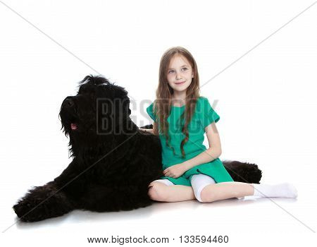Cute little girl hugging a big black dog-Isolated on white background