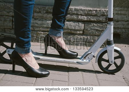 Female Feet In Shoes On A Scooter