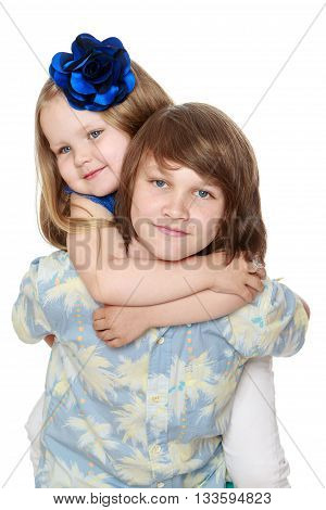 Little sister hugging the neck of his beloved older brother . close-up-Isolated on white background