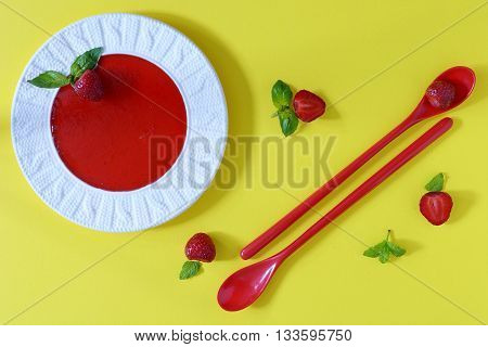 strawberry marmalade with basil and mint on yellow background