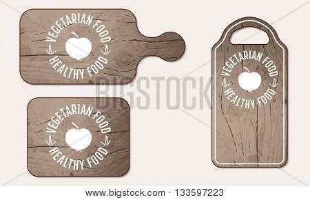 Wooden breadboard with icon of vegetarian food