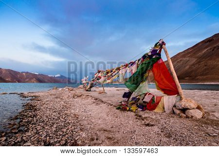 tibetian prayer flag beside Pangong Lake (Pangong Tso)Leh Ladakh India.