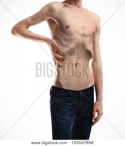 Skinny young man with anorexia on white background