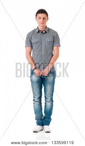 Unhappy young man standing full length isolated on white background