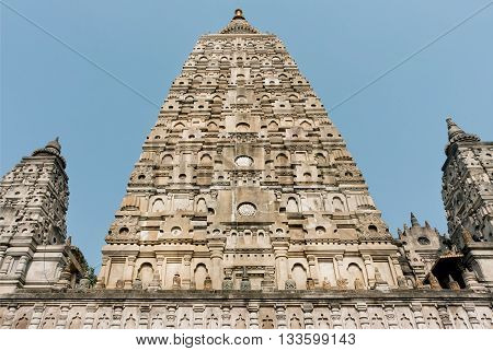 UNESCO World Heritage Site in Bodh Gaya, India. Carved dome of sacred Mahabodhi Temple historical Budhist temple