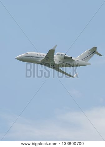 Moscow Region - June 4 2016: A small passenger plane Embraer ERJ-145LR takes off at Vnukovo airport in cloudy weather June 4 2016 Moscow Region Russia