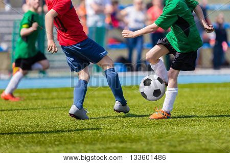 Football soccer match for children. Kids playing soccer game tournament cup. Physical education classes at school.