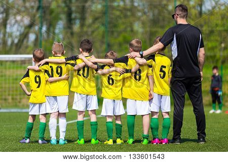 Young boys in soccer team standing united together on the sports field. Penalty soccer game during soccer football tournament for youth european teams.