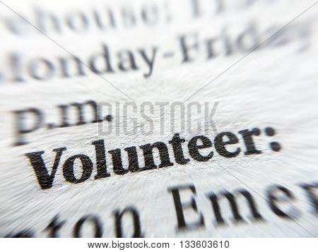 Volunteer word on blurred news paper background